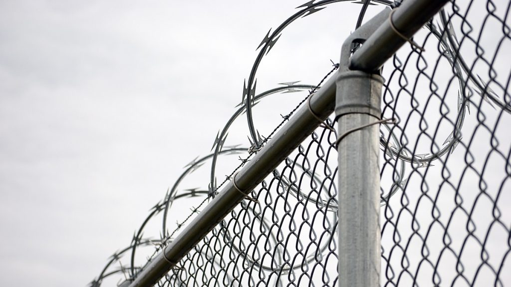 chain link fence with razor wire