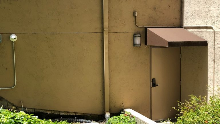 security camera pointed at building entrance